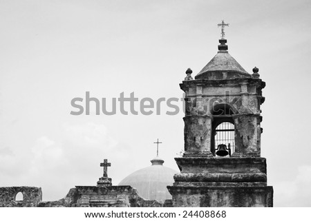 an old mission with three crosses at the peaks - stock photo