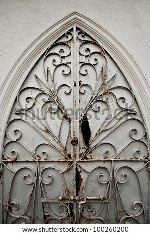 An Old Ornate Metal Door Gate