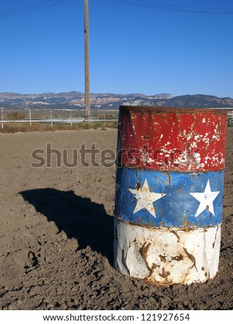 An old painted barrel in a rural rodeo arena.