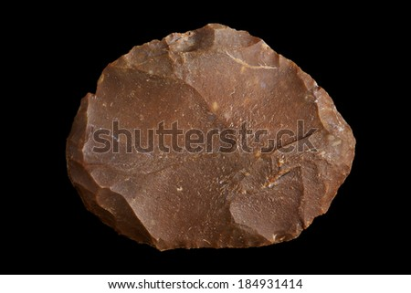 An old Paiute or Shoshone indian stone scraper from Northern Nevada used for cleaning hide and fat off of wild game. - stock photo