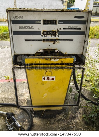 an old petrol pump in a long time closed down petrol station - stock photo