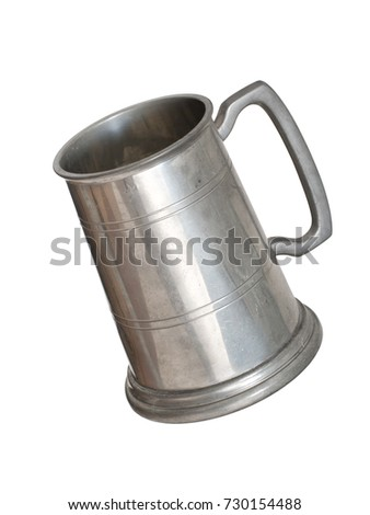 An old pewter drinking tankard, isolated on white. For beer or cider aka jug.