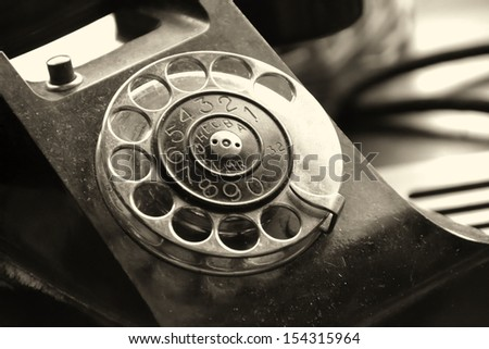 an old phone as a decoration in a restaurant in Prague - stock photo