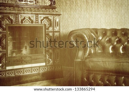 An Old Photo Of The Apartment With Chair And Fireplace - stock photo