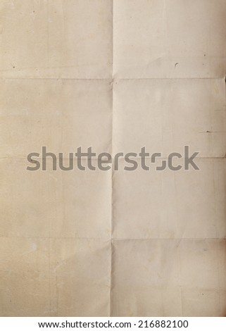 An old piece of paper with crease marks. - stock photo
