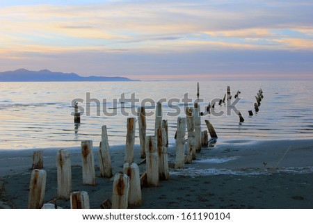 An old pipeline leading into the Great Salt Lake, Utah, USA. - stock photo