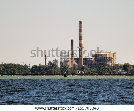 An old power-plant along the York river and Chesapeake Bay in Yorktown Virginia that was once active and is now non active - stock photo