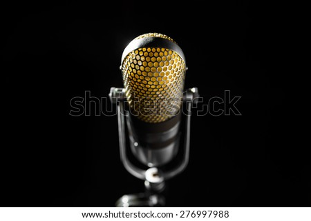 an old pro studio microphone, close up photo - stock photo