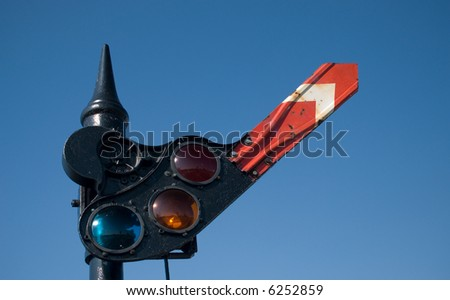 An old railroad stop and go signal, with one arm - stock photo