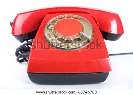 An old red phone on a white background - stock photo