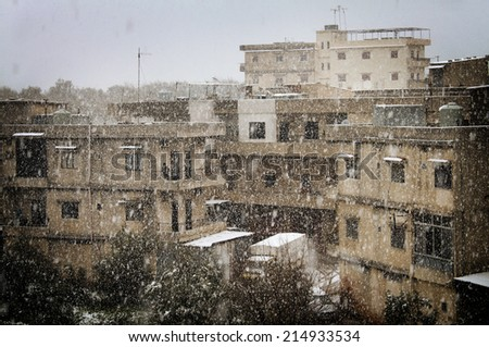 An old residential quarter during a snow blizzard. - stock photo