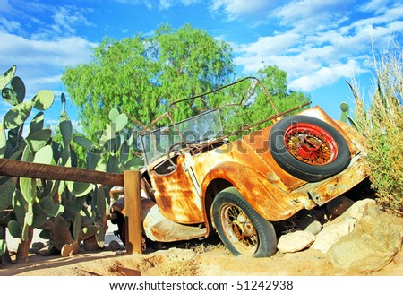 An old retired rusted truck in a field - stock photo
