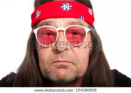 An old rock star icon wearing white sunglasses with pink lens on - stock photo