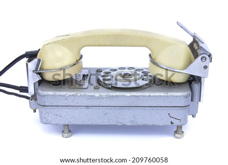An old rotary phone on white - stock photo