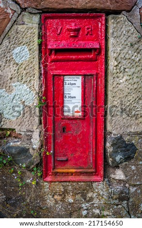 An old rural British Royal Mail post box from the reign of Queen Victoria - stock photo