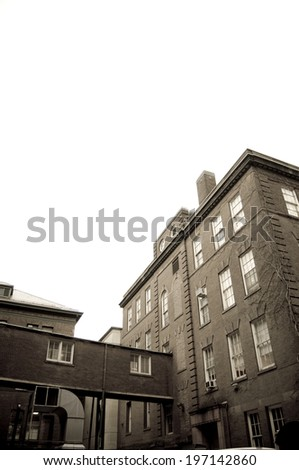 An old rustic building with vines along the building. - stock photo