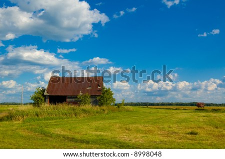 An old rusty barn in a field