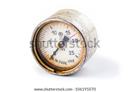 An old rusty gauge on white background - stock photo