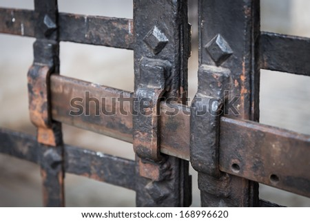 an old rusty metal bars with lock - stock photo