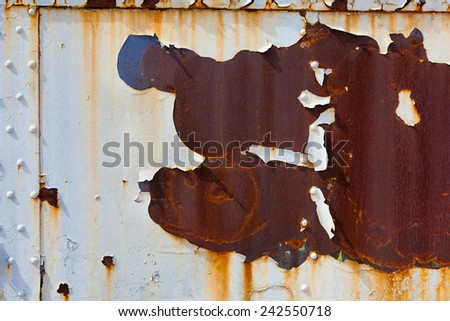 An old, rusty, peeling piece of steel for a background an grunge effect - stock photo