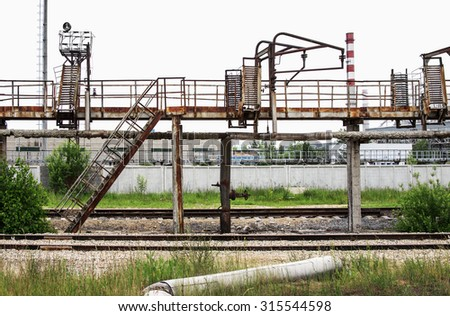 An old rusty staircase from a warehouse to a cat walk - stock photo
