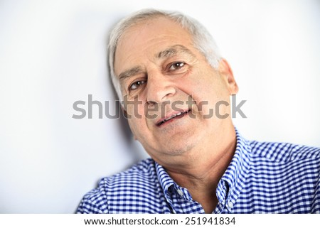 An old senior portrait in gray background - stock photo