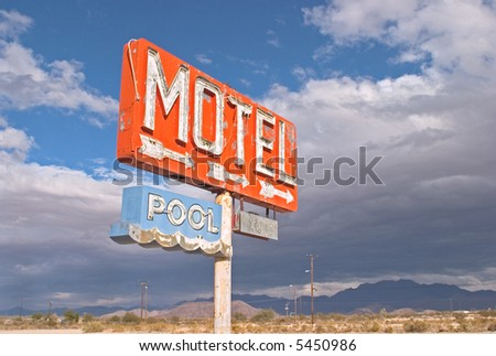 An old sign points to a motel complex that was never  built in Arizona's Mojave desert, - stock photo