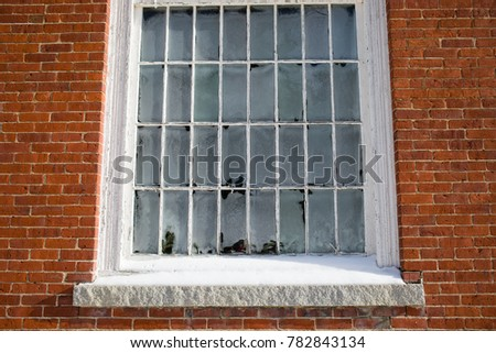 An Old Single Pane Window With Ice On The Inside