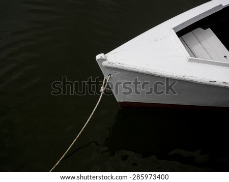 An old skiff moored to the dock. - stock photo