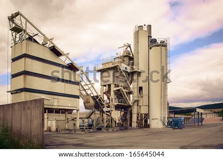 An old small factory in front of sky - stock photo