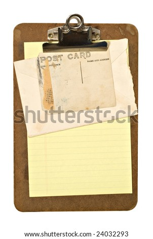 An old stained clipboard holding an envelope and old postcard. File has clipping path.