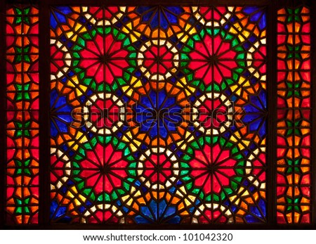 An old stained glass window of a church in Iran. - stock photo