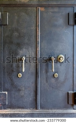 An old steel safe with a combination  as well as key lock  - stock photo