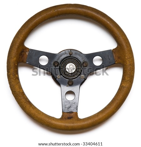 an old steering wheel on white - with clipping path. sign in the centrer is hand-craved and is not trademark - stock photo