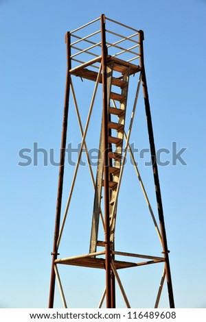 An old still watchtower against blue sky. concept photo of protection.