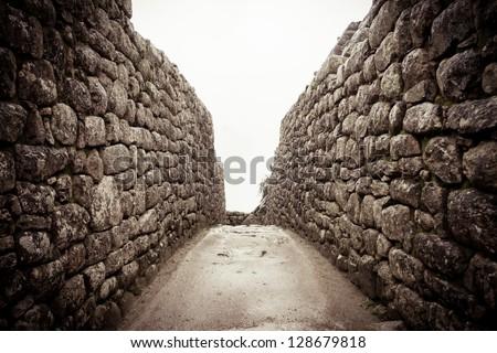 An old stone alley in machu picchu, Peru - stock photo