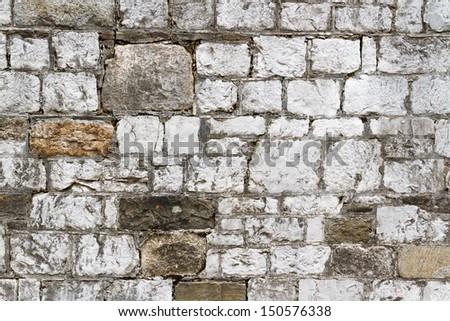 An old stone wall in Savannah, Georgia displays interesting textures. - stock photo