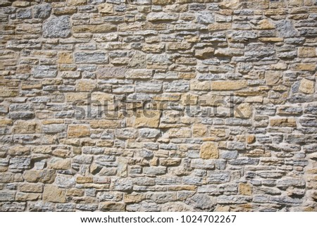 An old stone wall made of limestone and sandstone at a military fort in Minnesota