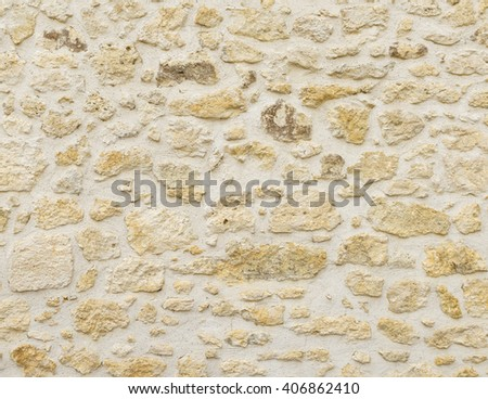 An old stone wall texture - stock photo