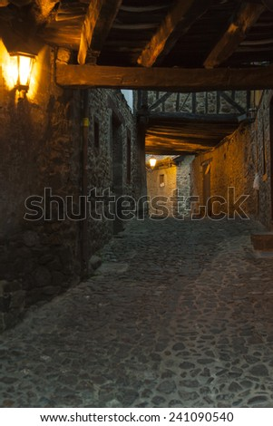 An old street first hour in the morning at Potes (Cantabria, Spain). - stock photo