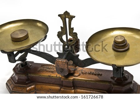 An old style beam balance with brass weights.. - stock photo