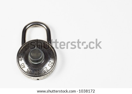 An old style silver combination padlock