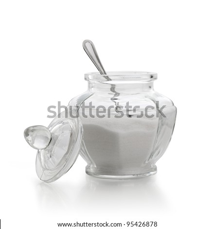 An old sugar bowl with spoon on white background - stock photo
