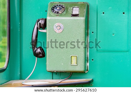 An old telephone from inside a telephone booth from the 1970s. The mobile phone of the old age. This is a Swedish model with the old emergency or SOS number. - stock photo