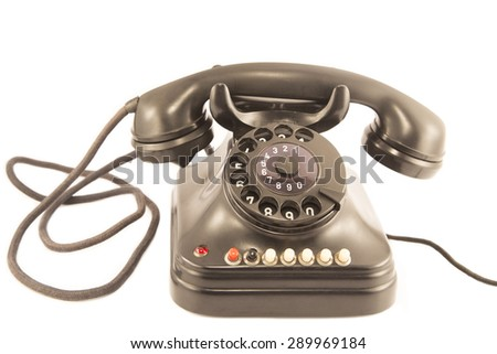 An old telephone isolated on white - stock photo