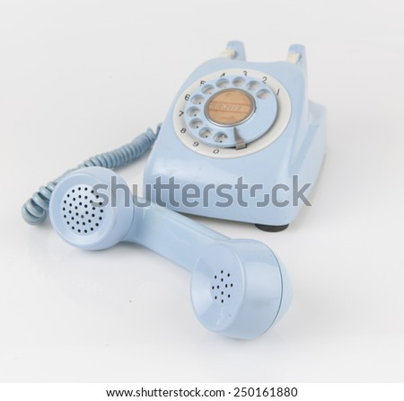 an old telephone with rotary dial - stock photo