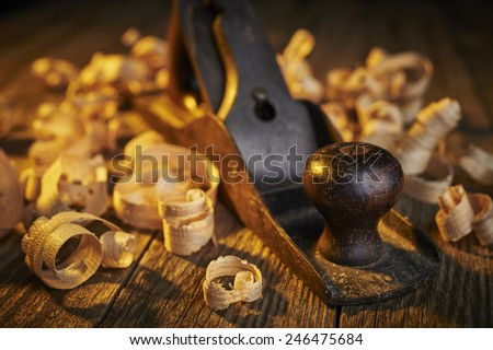 an old tool with wood shavings - stock photo