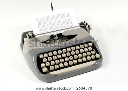 An old typewriter sits ready for use. - stock photo