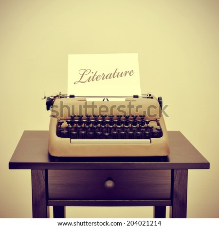 an old typewriter with a page with the word literature written in it, with a retro filter effect - stock photo