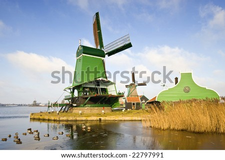 "An old, typically Dutch saw mill at the tourist attraction ""De Zaanse Schans"" on a nice winter day"